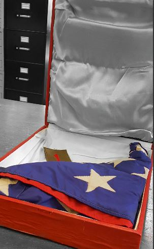 This American flag flew over Di An Base, Vietnam and is pictured in the original box.